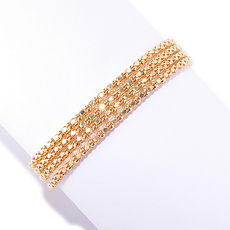 126-125 - Scintilloro™ Gold Embraced™ 8'' Four-Strand Diamond Cut Coreana Bracelet