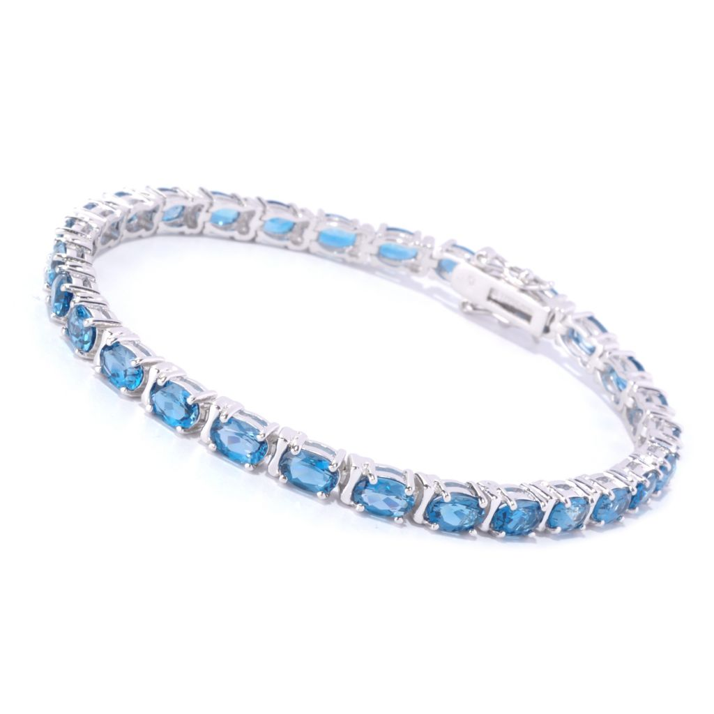 127-628 - Gem Insider Sterling Silver Oval Cut London Blue Topaz Tennis Bracelet