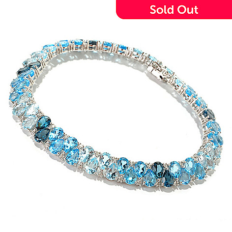 125-165 - Gem Insider Sterling Silver Pear Shaped Blue & White Topaz Bracelet