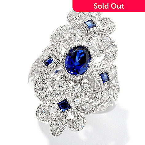 128-366 - Champenois® for Brilliante® 1.96 DEW Oval Cut Simulated Sapphire Fleur-de-lis Ring